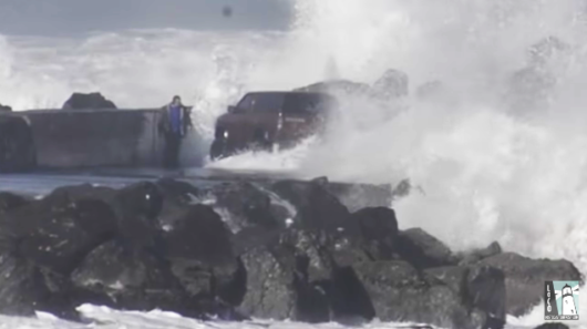 Man Rescued After Driving Into High Surf